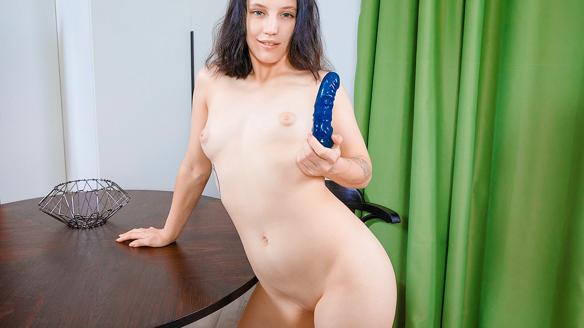 Naked lady plays with a toy
